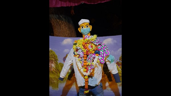 Mask Covered Kamanna Statue In Dharwad