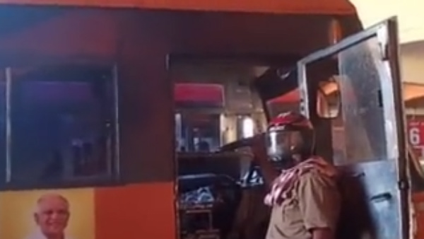 Bus Driver Wearing Helmet In Madikeri