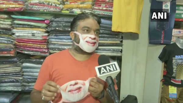 Kunal Paryani selling masks with PM Modis face printed on it