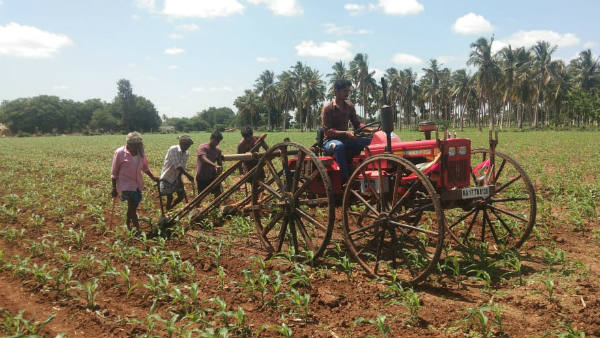 Farmers Using Modern Machinery For Agricultural Activities