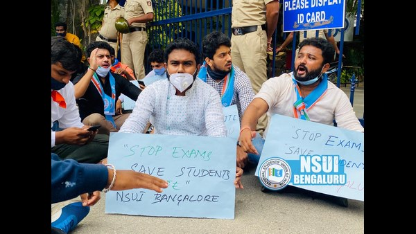 NSUI protest in front of Christ college demanding the cancellation of online examination