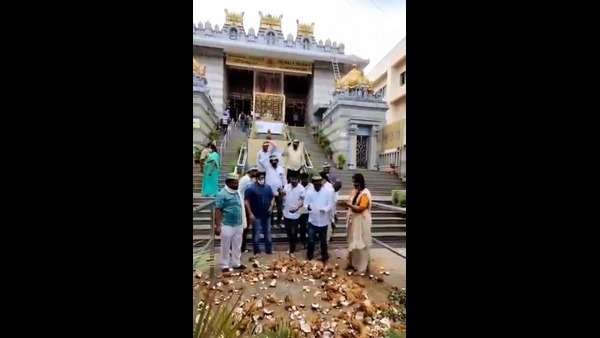 Followers Breaks 1001 Coconuts In Bengaluru Temple For DK Shivakumar Speedy Recover From Covid-19
