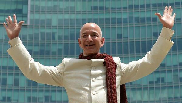 Jeff Bezos becomes the first person in the world to hit a net worth of $200 billion