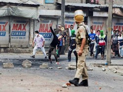 Eid Marred By Pelting Teargas In Kashmir Protesters And Police Clash