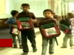 Akhilesh Yadav Makes An Appearance On School Bags Distributed In Gujarat