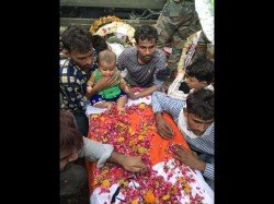 Jaipur Martyrs 5 Month Old Daughter Sits On His Coffin