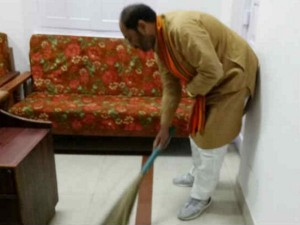 Minister Cleans His Office Premises With Groom Stick