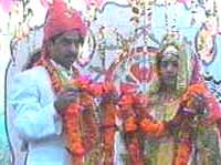 Bride and groom exchanging garlands
