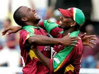 Dwayne Smith, left, celebrates with teammate Corey Collymore after the dismissal of Pakistans Mohammad Yousuf
