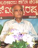 S.L.Bhyrappa listening a question
